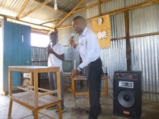 Willis teaching during Children's church.