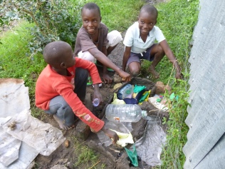 Building mud playhouses!
